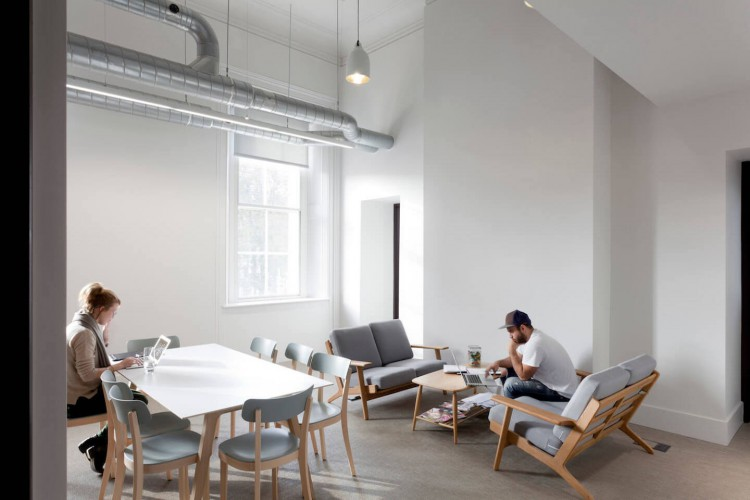 Breakout space with soft furniture creating an area for businesses to work away from the office.