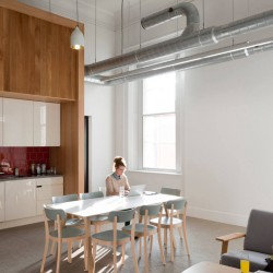 Open kitchen with lots of space with seating area to either eat or work in Paddington.