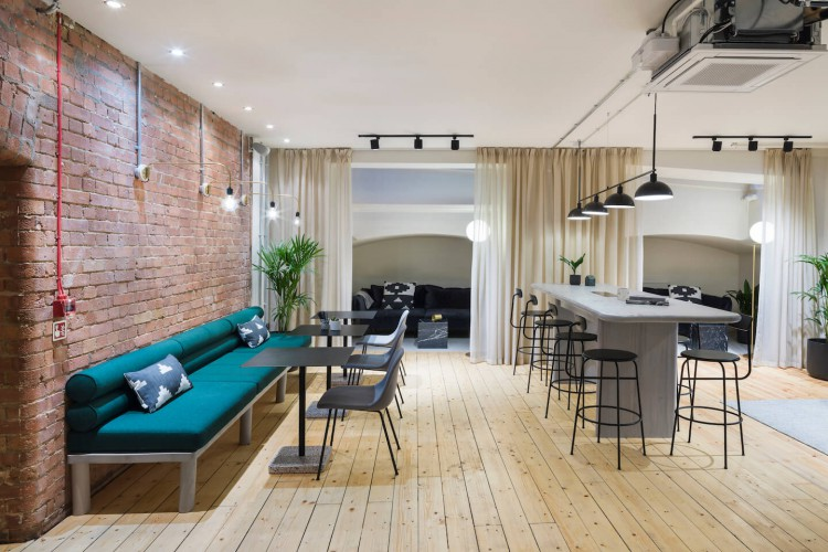 Co-working space with private booths in this Victorian warehouse with original exposed brick and wood flooring.