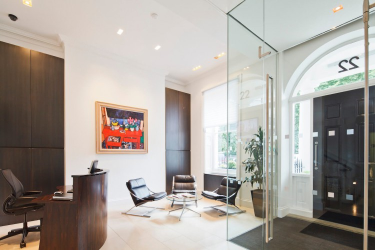 Reception area for Georgian Manchester Square property with private offices.
