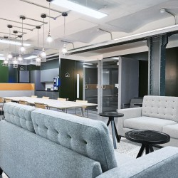 Contemporary & comfortable breakout space in an warehouse style office space in The Embassy Tea House building on Union Street.