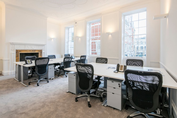 Front facing private serviced office at 11 Golden Square, Soho, London W1F 9JB. The managed offices enables businesses to occupy space in the heart of soho on flexible terms.