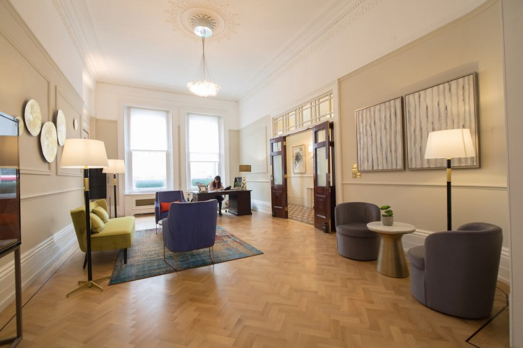 Serviced office reception at Grosvenor Gardens, Victoria, meeting and greeting clients based at the building.
