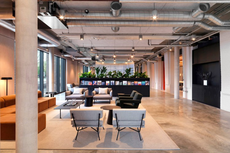 Contemporary breakout space surrounded by 60s architecture for office workers at flexible workspace building TOG - Tintagel House.