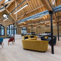 Stunning serviced office penthouse suite at Notcutt House offering businesses a self-contained floor with desks, designer furniture and exposed brickwork.