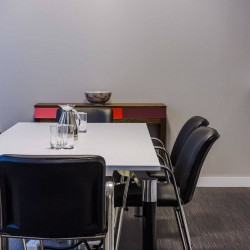 Meeting room with conference calling facilities available for companies working at this office space in Queens Road, Wimbledon.