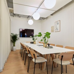 Meeting room with plenty of natural light and modern furnishings for businesses to host team or client meetings at this flexible office space in High Holborn, London.