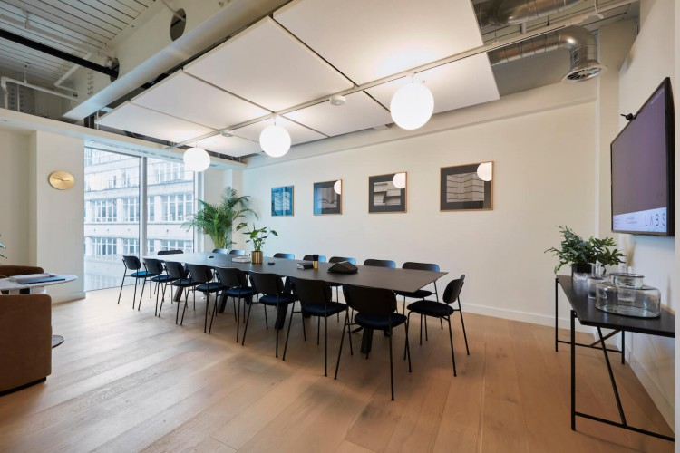 Boardroom filled with natural light for large business meetings at the beautifully designed flexible office space in High Holborn, London.