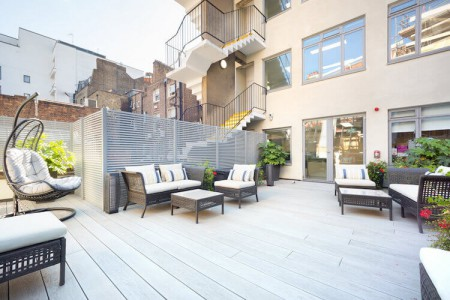 Stunning roof terrace facilities with breakout furniture and comfortable chairs for businesses to host events and meetings at this serviced office space in Newman Street in Fitzrovia.