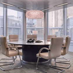Stunning meeting room facilities with bespoke tables and comfortable chairs for businesses to host meetings at this serviced office space in Old Broad Street in the City of London.