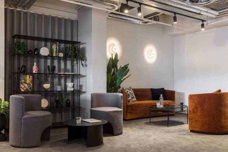 Orion House, operated by The Office Group, offers contemporary soft seating area with designer furnishings for office occupiers to use outside of their private office.