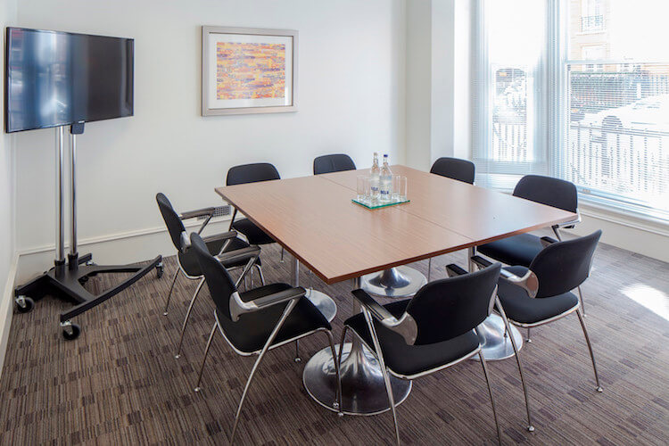 Luxurious meeting room for businesses to use at the office space in 52 Brook St, Mayfair, London W1K 5NE.