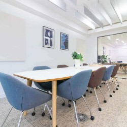 Boardroom area with meeting room tables, whiteboards and screens for office staff to utilise at the Crane Building, Southwark.