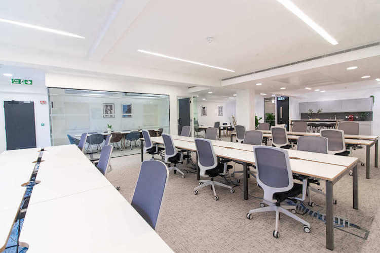 Managed office floor with kitchen and meeting rooms already in place at the Crane Building, Southwark, offering business' personalised office floors on flexible terms.