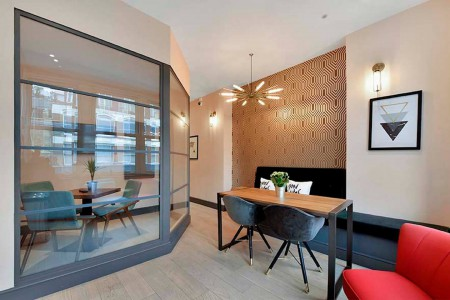 Communal meeting space for companies to use in the serviced office building on Rivington Street.
