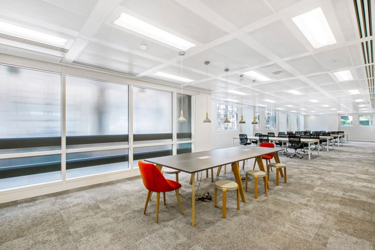 Dedicated breakout areas and workspace benches for the office occupiers to utilise within the self-contained private office floor at Senator House, Queen Victoria Street.