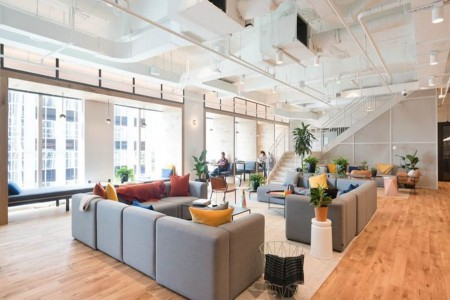 Co-working space in Hoxton dedicated to Wework, providing art-filled lounges and contemporary break-out space