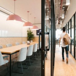 Collaborative conference room in this modern building dedicated to Wework, providing space and convenience to thrive