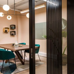 Stunning meeting room facilities with bespoke tables and comfortable chairs for teams/businesses to host meetings at this serviced office space in New King's Rd, Fulham.