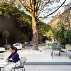 Outdoor terrace with bespoke tables and seating areas for teams/businesses to use outside of their office space in New King's Rd, Fulham.