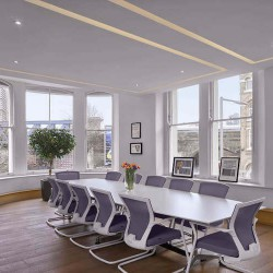 Meeting room with exposed brickwork, conference calling facilities and TV Screen for companies to use at this office space at The Flat Iron Building in the heart of London Bridge.