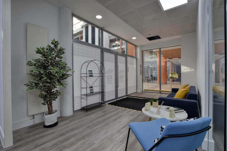 Serviced office building entrance offering contemporary office space in Marina Studios located in Chelsea Harbour, providing businesses their own customised, branded workspace.