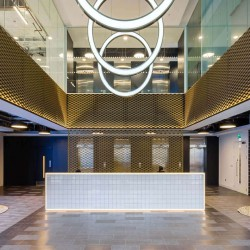 Stunning building reception at Alie Street located within the vibrant Aldgate area, this bright and inviting office space has been designed to offer businesses their own customised, branded workspace.
