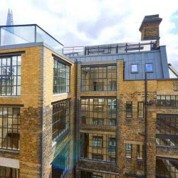 Flexible managed office building on Clink Street in London Bridge providing companies with self-contained office space for teams of 50-60 staff.