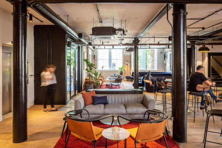 Contemporary & comfortable breakout space in The Ministry's flexible workspace building on Borough Road, offering tenants various workspace areas.