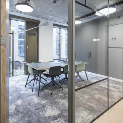 Meeting room facilities with floor to ceiling windows and AV equipment provided at the verse building in Old Street for businesses to hire.