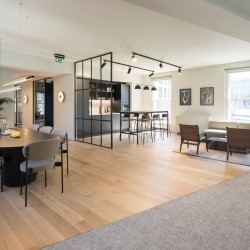 Office occupiers have access to the contemporary kitchen area with added breakout space at Ely Place, Farringdon.